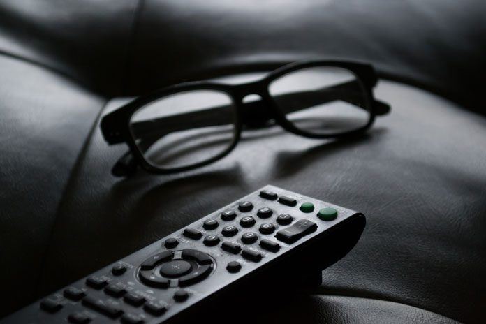 tv remote and glasses